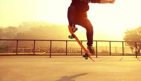 Skateboarder skateboarding at skatepark Royalty Free Stock Photo