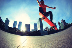 Skateboarder skateboarding at sunrise city Royalty Free Stock Photography