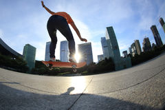 Skateboarder skateboarding at sunrise city Stock Images