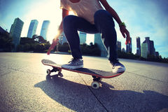 Skateboarder skateboarding at sunrise city Royalty Free Stock Image