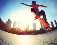 Skateboarder skateboarding at sunrise city Royalty Free Stock Images