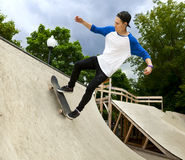 Skateboarder in the skatepark Royalty Free Stock Images