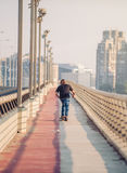 Skateboarder skates over a city bridge. Free ride street skatebo Royalty Free Stock Photography
