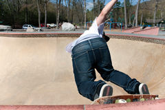 Skateboarder Skating the Bowl Stock Images
