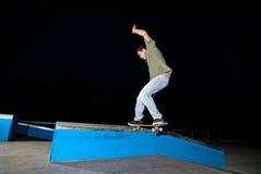 Skateboarder on a slide Royalty Free Stock Images