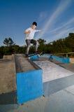 Skateboarder on a slide Stock Image