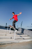 Skateboarder on a slide Stock Photography