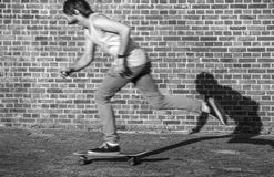 Skateboarder at speed through the city Stock Photography
