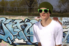 Skateboarder standing in front of graffiti wall. Boucherville Skatepark, Quebec, Canada Royalty Free Stock Photography