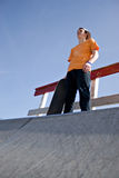 Skateboarder Standing on a Ramp Stock Images