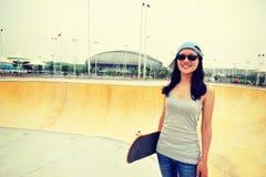 Skateboarder standing on skatepark with skateboarder Royalty Free Stock Images