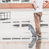 Skateboarder standing and thinking about new trick Royalty Free Stock Images