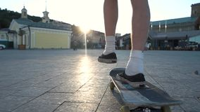 Skateboarder in the street. Person on skateboard in slow-mo. Towards the sun. Energy of young generation stock footage