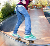 Skateboarder to jump the railing Stock Images