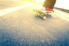 Skateboarder trick in beach road Stock Photo
