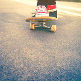 Skateboarder trick in beach road. With sun Stock Photography