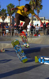 Skateboarder Jumping. Skateboarder doing tricks at Venice Beach, CA famous boardwalk and birth of Dog Town Royalty Free Stock Images