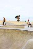 Skateboarder at Venice Beach, CA. Young skateboarder doing tricks and jumps, Venice Beach, CA 9/2014 Royalty Free Stock Image