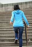 Skateboarder walk on stairs Stock Photo