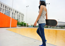 Skateboarder walk Royalty Free Stock Image