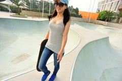 Skateboarder walk Stock Photo