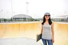 Skateboarder standing on skatepark with skateboarder Stock Image