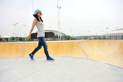 Skateboarder walk Royalty Free Stock Photo