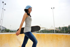 Skateboarder walk Stock Images