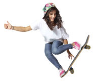 Skateboarder woman jumping showing thumbs up Royalty Free Stock Photos