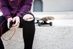 Skateboarder Woman Street Wear Fashion Concept Stock Photos