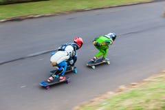 SkateBoarders τρία προς τα κάτω ταχύτητα-θαμπάδα Στοκ Εικόνα