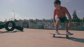 Skateboarders doing tricks during sunset in slowmotion. stock video footage