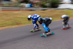 SkateBoarders DownHill SpeedBlur Royalty Free Stock Photo