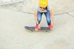 Skateboarders jumping on a skateboard park Stock Photos