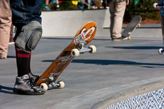 Skateboarders Prepare To Drop In At Skateboard Park Bowls Royalty Free Stock Images