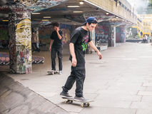 Skateboarders at skatepark on South Bank, London Stock Image