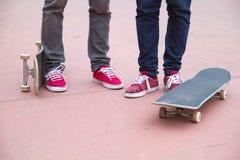 Skateboarders, skaters with skateboards in skatepark royalty free stock photography