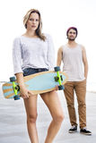 Skateboarders Standing On Footpath Royalty Free Stock Photos
