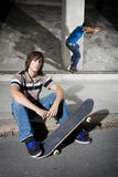 Skateboarders in underground parking lot Stock Photos