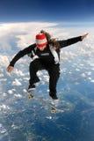 Skateboardfahrer über den Wolken Lizenzfreies Stockfoto