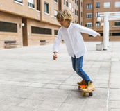 Skateboardfahrerkind Stockbild