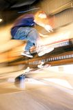 Skateboarding 001. A skateboarder does a kick flip on a ramp Royalty Free Stock Images