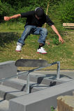 Skateboarding. Skateboarder doing a trick at the local skate park Royalty Free Stock Images