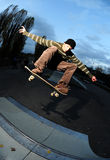 Skateboarding. Skateboarder doing a trick at the local skate park Stock Photography