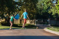 Skateboarding Boy Girl Royalty Free Stock Photo
