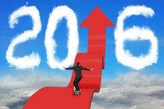 Skateboarding businessman on arrow upward path with 2016 sky cloudscape. Skateboarding businessman balancing on red arrow upward path with 2016 shape clouds and royalty free stock photography