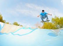 Skateboarding and concrete wave Stock Photos