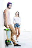 Skateboarding couple Stock Image