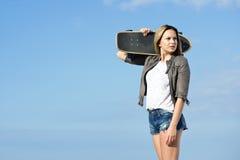 Skateboarding girl looking back Stock Image
