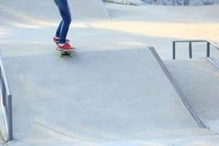 Skateboarding legs riding on a skateboard Royalty Free Stock Photo